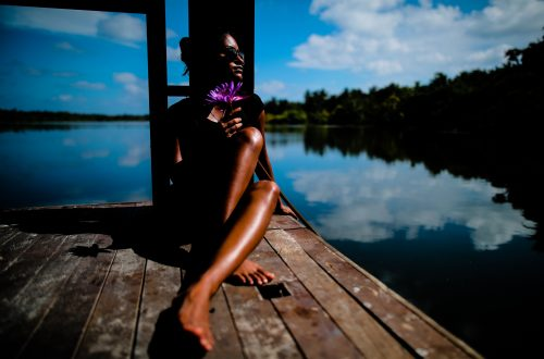 woman sitting near body of water